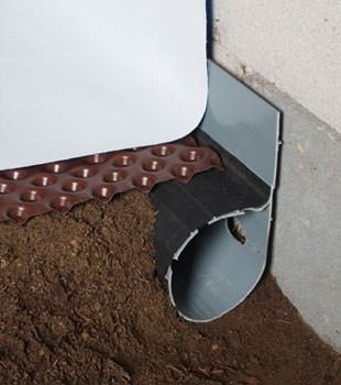 Closeup of a crawl space drainage system installed in Linwood