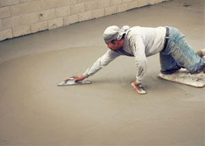 smoothing out the grout in a slab releveling project in Absecon