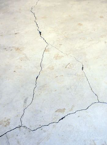 severely cracked, heaving slab floors in a home in Woodstwon