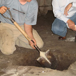 Digging a hole for the engineered fill used in a crawl space support system installation in Absecon