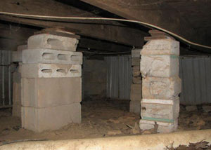 crawl space repairs done with concrete cinder blocks and wood shims in a Pleasantville home