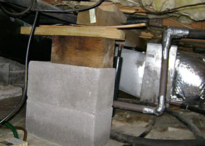 a poorly designed crawl space support system installed in a Glassboro home