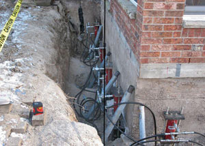 Foundation push piers installed around a house with a foundation settlement issues in Linwood