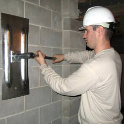 installing a wall anchor to repair an bowing foundation wall in Egg Harbor Township