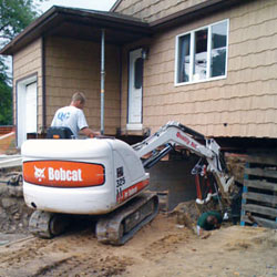 Excavating to expose the foundation walls and footings for a replacement job in Voorhees