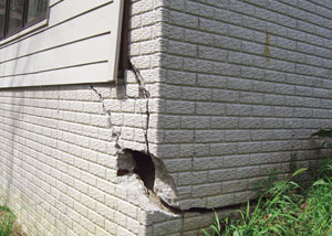A severely damaged foundation wall in Williamstown