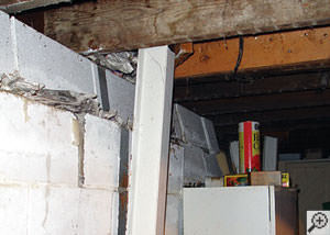 A failing foundation wall and i-beam support in a Vineland home