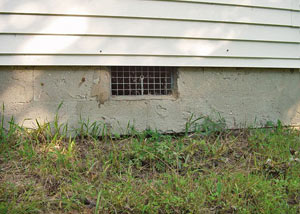 Open crawl space vents that let rodents, termites, and other pests in a home in Hammonton
