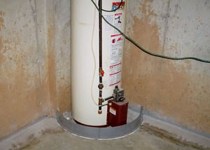 A water heater in Cape May that's been protected by the FloodRing® and a perimeter drain system.