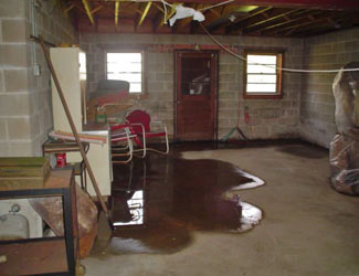 a flooded basement floor in a Northfield home