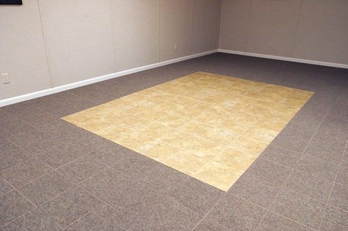 tiled and carpeted basement flooring installed in a Bridgeton home