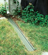 A recessed gutter drain extension installed in Northfield, New Jersey